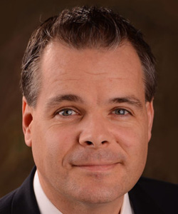 Marc Dyman, Executive Vice President and Chief Revenue Officer for FiberLight